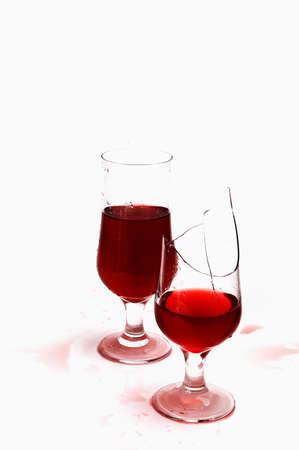 bar ware: Broken glass with wine and drops ,isolated on white background