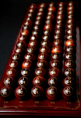 wooden bingo balls in a row  photo