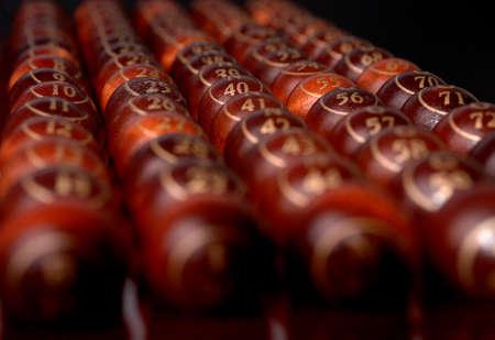 wooden bingo balls in a row Stock Photo - 12805356