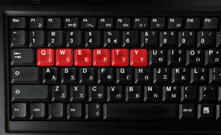 qwerty: Computer laptop keyboard showing qwerty letters colored in red
