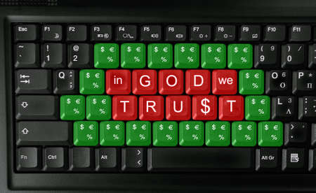 mercantile: keyboard with slogan  in god we trust  -concept of mercantile and greed  Stock Photo