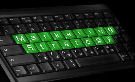 laptop keyboard and text   Marketing Strategy   colored green