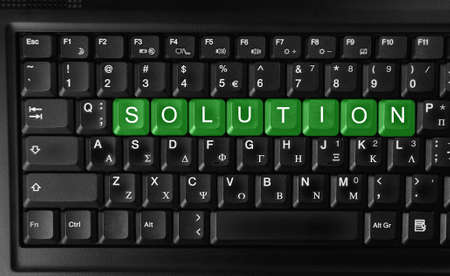 Word of solution on green keyboard button   photo