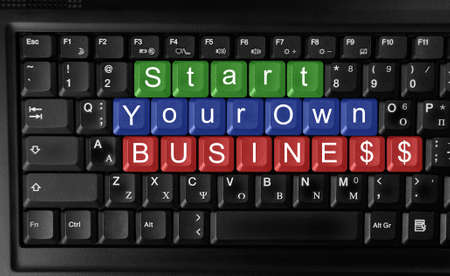 Laptop keyboard ,text  start your own business   colored keys photo