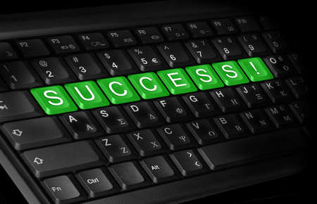 laptop keyboard and text   Success   colored green   photo