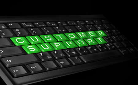 laptop keyboard and text   CUSTOMER SUPPORT   colored green   Stock Photo