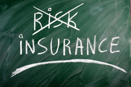 insurance risk crossed out green blackboard  photo