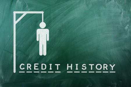 gallows game-businessman bancruptcy on green blackboard and text  credit history  photo