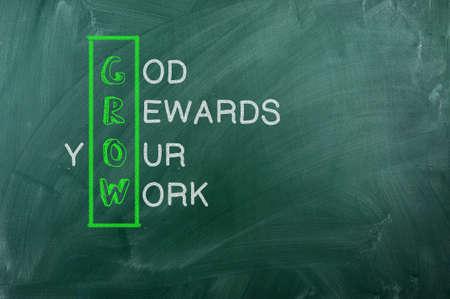 christian trust: GROW acronym  God Reward Your Work  , written with  chalk on blackboard