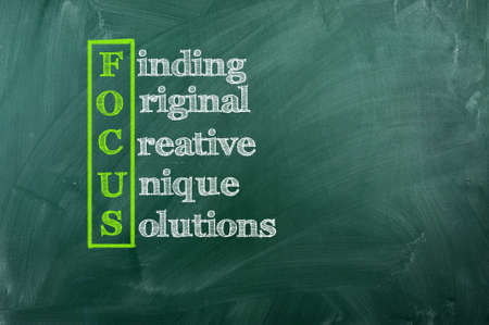 Focus acronym  - Finding,Original,Creative,Unique,Solutions Stock Photo