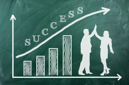 Chart on green blacboard,man and woman in success Stock Photo - 14771229