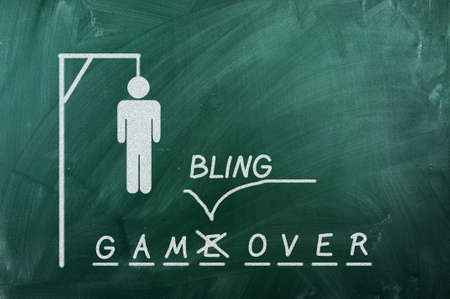 gallows game on green blackboard and text Gambling  Over .Gambling addiction concept