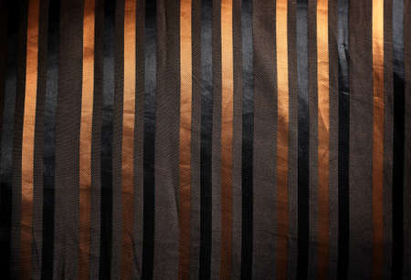 shiny luxury  silk fabric with golden stripes photo