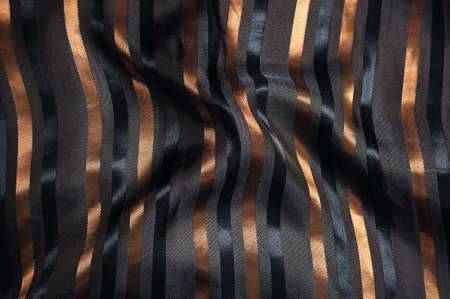 shiny luxury  silk fabric with golden stripes Stock Photo