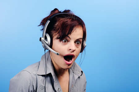 Beautiful young customer assistant wearing a headset with surprised look Stock Photo - 19455606