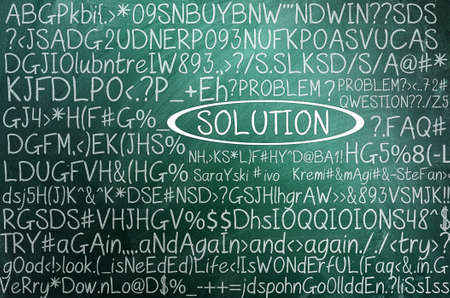 Solution concept in word tag cloud on green chalkboard photo