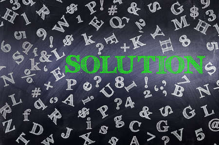Solution concept in word tag cloud on blackboard photo