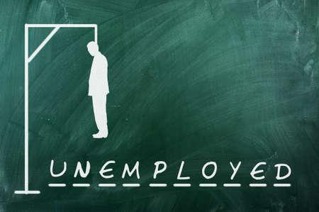 ahorcada: Juego del ahorcado en la pizarra verde, el concepto de desempleo Foto de archivo