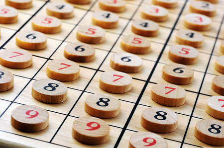 Wooden sudoku numbers in order . Lucky concept  photo