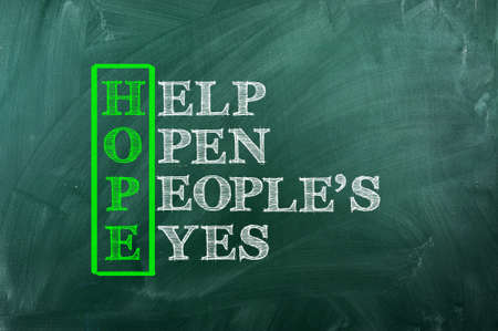 Acronym of Hope written  on green chalkboard photo