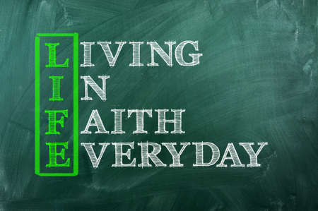 living wisdom: Acronym concept of Life  and other releated words on green chalkboard