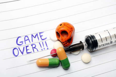 Game Over- Drug abuse concept on notebook Stock Photo