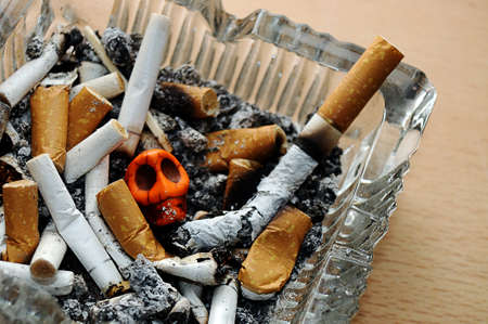Cigarette in An Ashtray And Skull inside