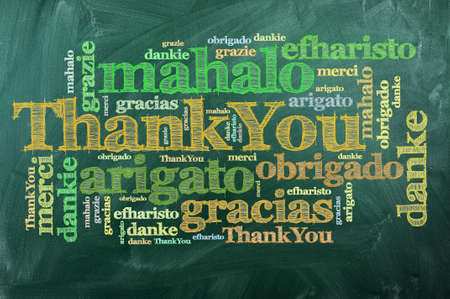 with thanks: thank you in different languages on green chalkboard Stock Photo