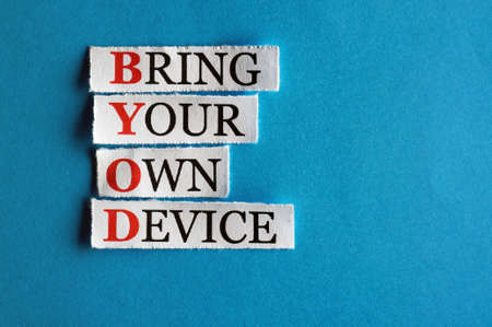 BYOD  acronym  in business concept, words on cut paper hard light photo