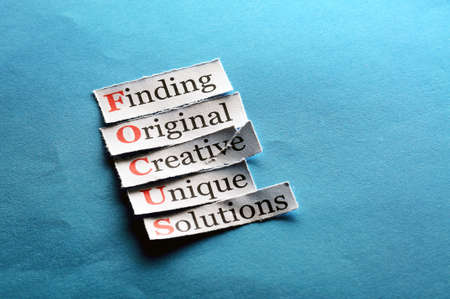 Focus  acronym  in business concept, words on cut paper hard light Stock Photo
