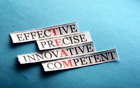 communicative: team  acronym  in business concept, words on cut paper hard light
