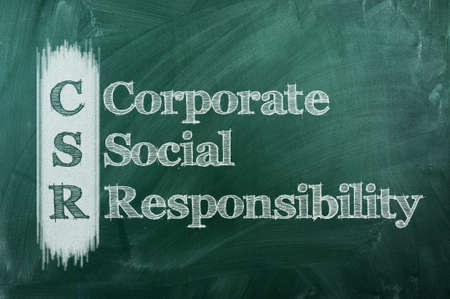 corporate social responsibility ( CSR ) concept on green  chalkboard  photo