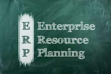 erp - enterprise resource planning on green chalkboard