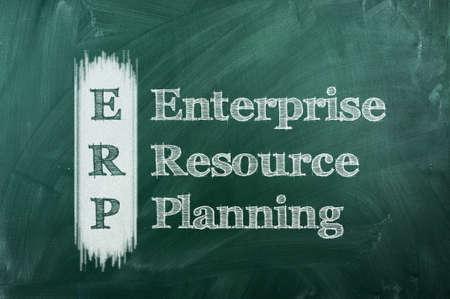 erp - enterprise resource planning on green chalkboard