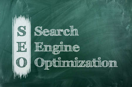search engine optimization: Conceptual SEO acronym on green chalkboard  Search Engine Optimization Stock Photo