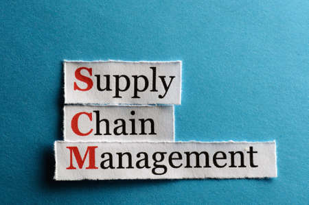 SCM Supply Chain Management acronym on blue paper photo