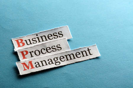bpm: BPM business process management on blue paper Stock Photo