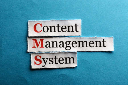 CMS Content Management System abbreviation on blue paper photo