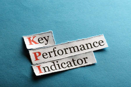 key performance indicator, KPI  on blue paper