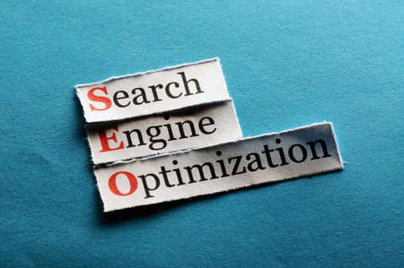 Conceptual SEO acronym on blue - Search Engine Optimization  photo