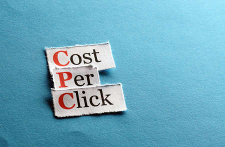 cpc: CPC, cost per click  on blue paper Stock Photo