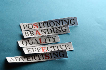 Sales  acronym in business concept, words on cut paper hard light photo