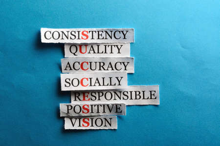 Success acronym in business concept, words on cut paper hard light  photo