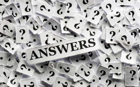 answers  question marks on white papers -hard light photo