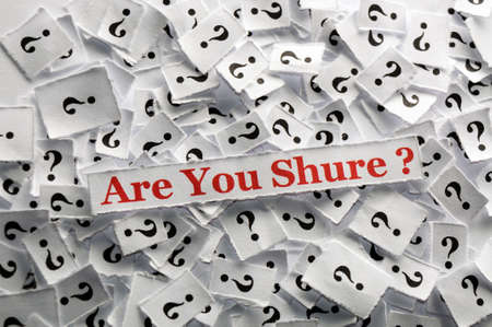 shure: are u shure  question marks on white papers -hard light Stock Photo