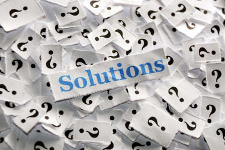 solutions on question marks on white papers -hard light photo