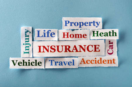 insurance Word Cloud  printed on  paper on blue font photo