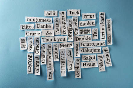 Thank You Word Cloud  printed on  paper on blue font photo
