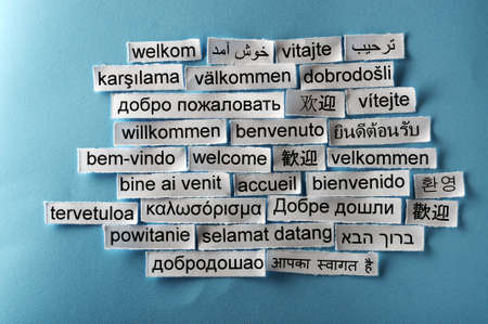 welcome  Word Cloud  printed on  paper on blue font photo