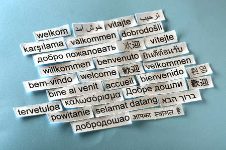 multilingual: welcome  Word Cloud  printed on  paper on blue font